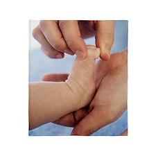 Massaging baby toes Throw Blanket
