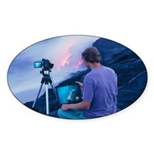 Man taking photographs of a lava fl Decal