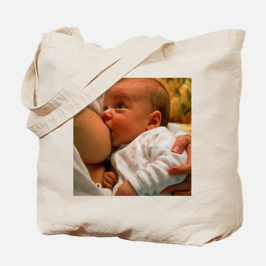 Mother breast-feeding her 3 month old bab Tote Bag