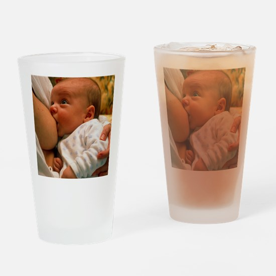 Mother breast-feeding her 3 month o Drinking Glass