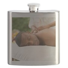 Young man having a back massage Flask