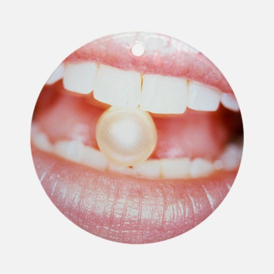 Pearl between teeth Round Ornament