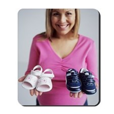 Pregnant woman with baby shoes Mousepad
