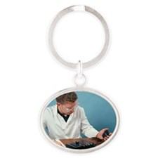 Reaction rate experiment Oval Keychain