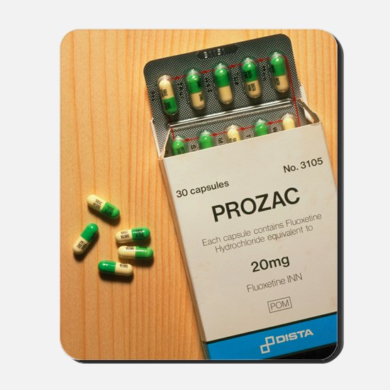 Prozac pack with pills on wooden surface Mousepad