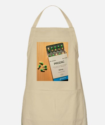 Prozac pack with pills on wooden surface Apron
