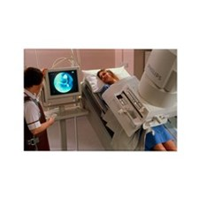 Radiographer conducts barium meal Rectangle Magnet