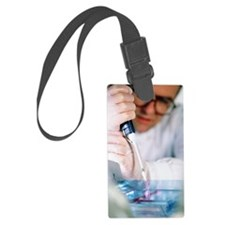 Samples of DNA being loaded onto Luggage Tag
