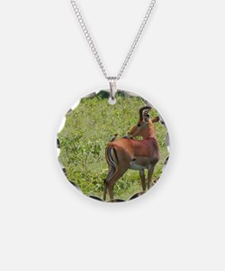 impala buck with oxpeckers k Necklace