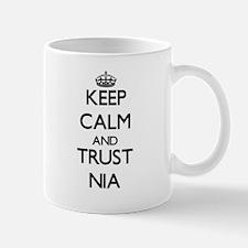 Keep Calm and trust Nia Mugs