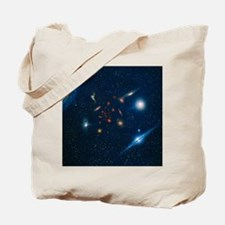 Artwork of various galaxies showing red s Tote Bag