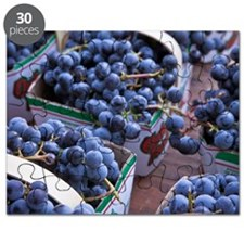Baskets of concord grapes displayed on tabl Puzzle