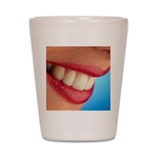 Close-up of a woman's mouth showing hea Shot Glass