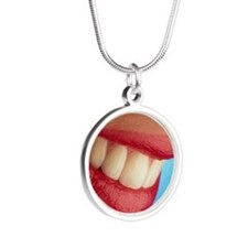 Close-up of a woman's mouth  Silver Round Necklace