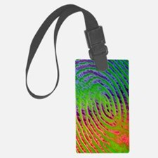Coloured SEM of details of a hum Luggage Tag