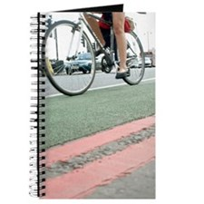 Cyclist in a cycle lane Journal