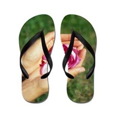 Flower held in hands Flip Flops
