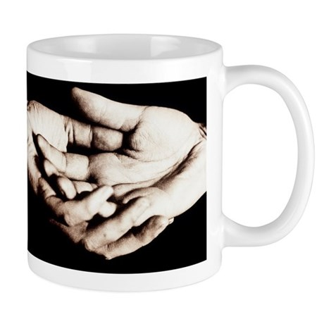 Front view of cupped hands held togethe Mug