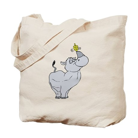 Rhino spinning dreidel on his horn Tote Bag
