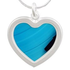 Blue vinyl playing on the tu Silver Heart Necklace