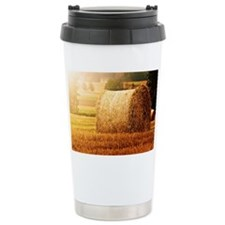Hay bale on field. Travel Mug