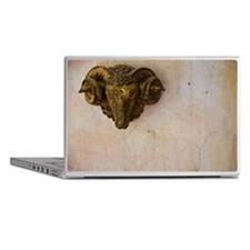 Sculpture of Ram's Head on Wall Laptop Skins