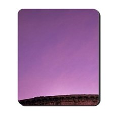 The sun setting purple behind the Coliss Mousepad