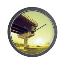 A freeway over pass under construction Wall Clock