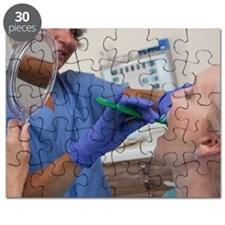 Female dental hygienist brushing the teeth  Puzzle
