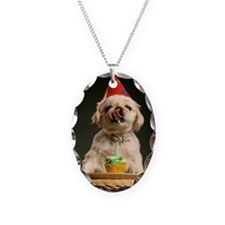 Dog with a cupcake likcing its Necklace