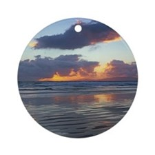Waves washing up on beach Round Ornament