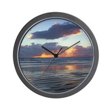 Waves washing up on beach Wall Clock