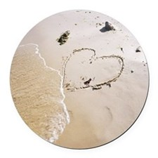 A heart on a beach. Round Car Magnet