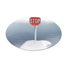 Stop sign on a melting iceberg. Oval Car Magnet