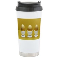 Golden eggs in egg cups Travel Coffee Mug