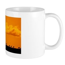 Silhouettes of wildebeests on a ridge Mug