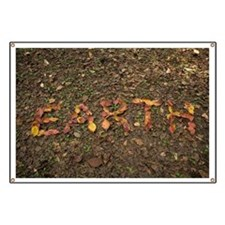 'EARTH' written with fallen leaves that tur Banner