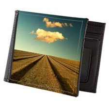 Ploughed field with blue sky and cloud Mens Wallet