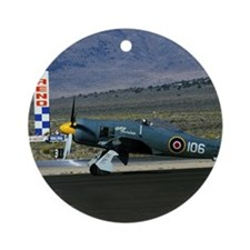 Antique military aircraft on runway Round Ornament