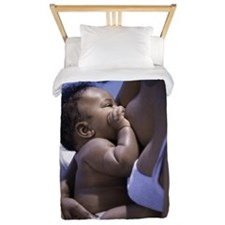 High angle view of a mother breastfeedi Twin Duvet