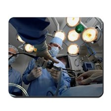 Surgeons operating on patient Mousepad