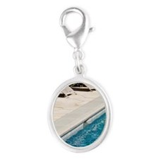 Lounge Chairs Next to Swimming  Silver Oval Charm