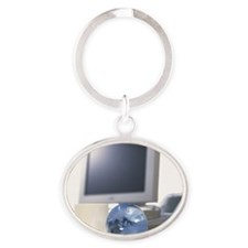 Photography of a glass globe and com Oval Keychain