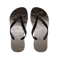 Rain drops falling into water making ri Flip Flops