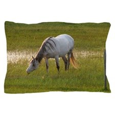 A white horse grazing in pasture is li Pillow Case