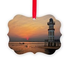 Lighthouse at sunset Ornament