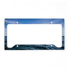 Clouds over deep blue ocean License Plate Holder