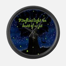 Fireflies light the heart of nigh Large Wall Clock