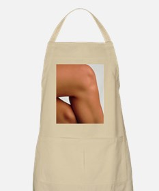 Side view of the knee of a woman Apron