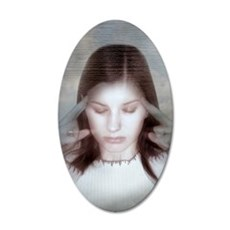 Woman holding her temples 35x21 Oval Wall Decal
